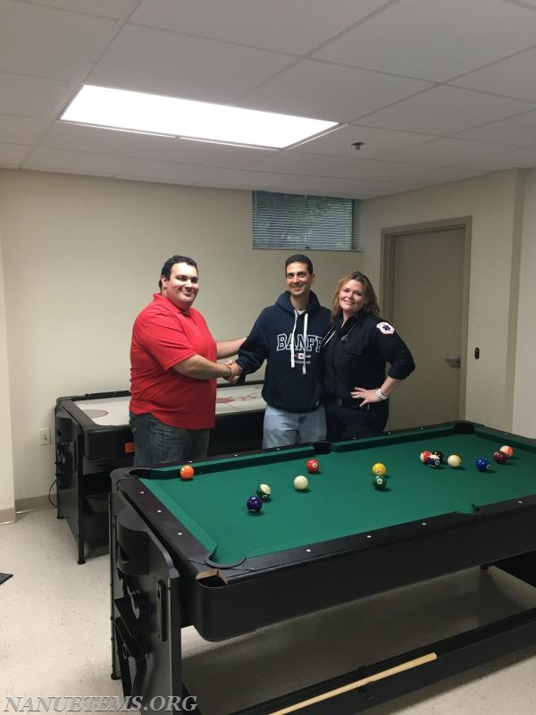 Assistant Chief Delgado and EMT LaFrancois  thank Dr. Habif for the donation of a new pool table and a new air hockey table!
